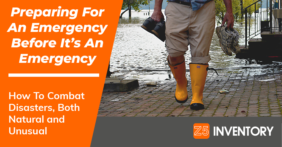 A man heads away from a flood wearing galoshes, because he's at least that prepared.