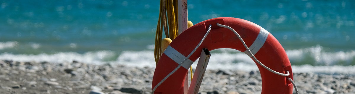 A life preserver on a dirty beach illustrates the need for something to hang onto in 2020.