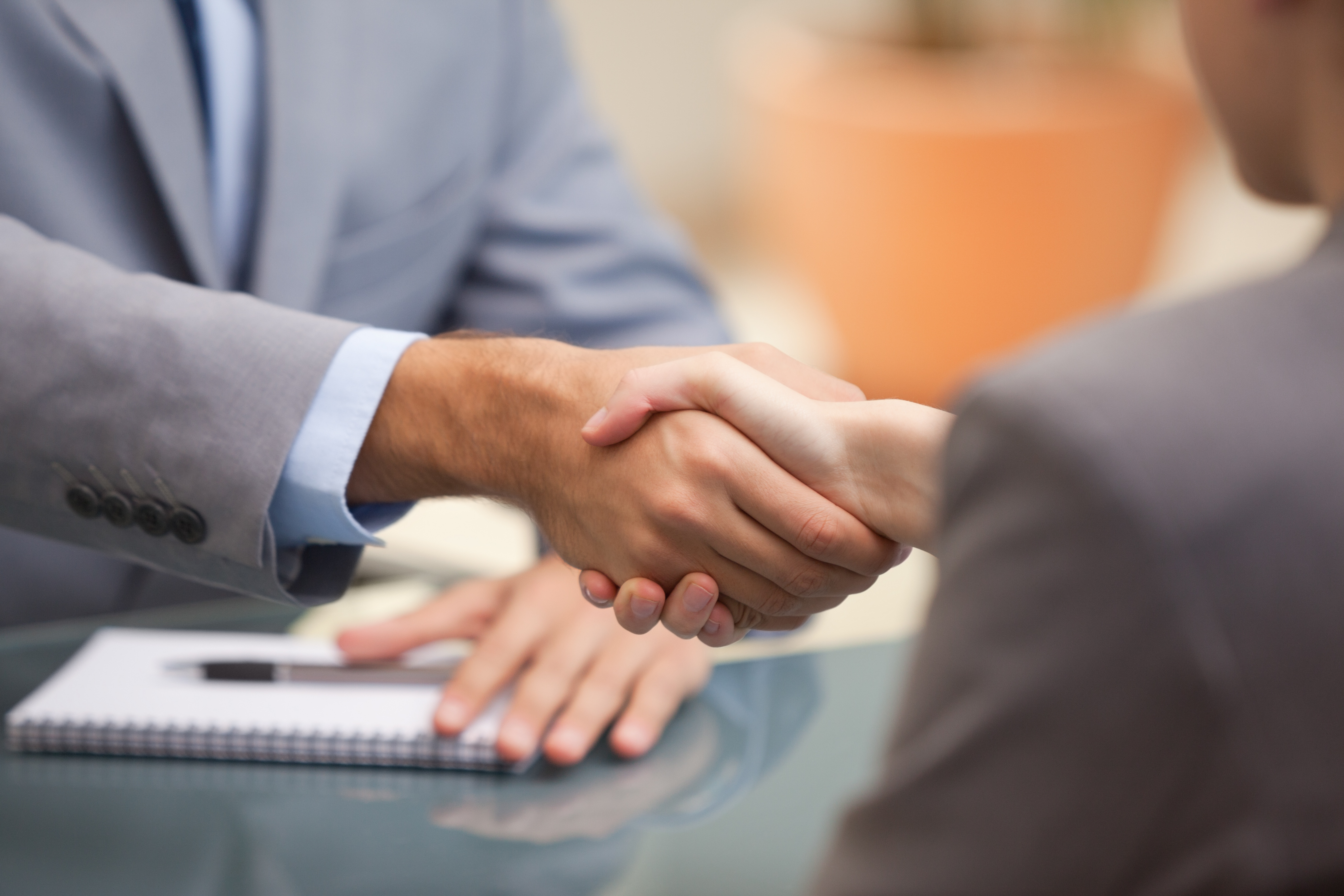 Stock Photo of a manager shaking hands with a new hire.