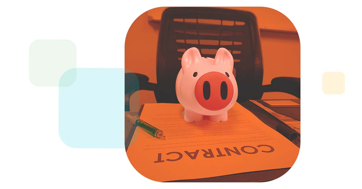 colored chiclets reveal a piggy bank sitting atop a contract