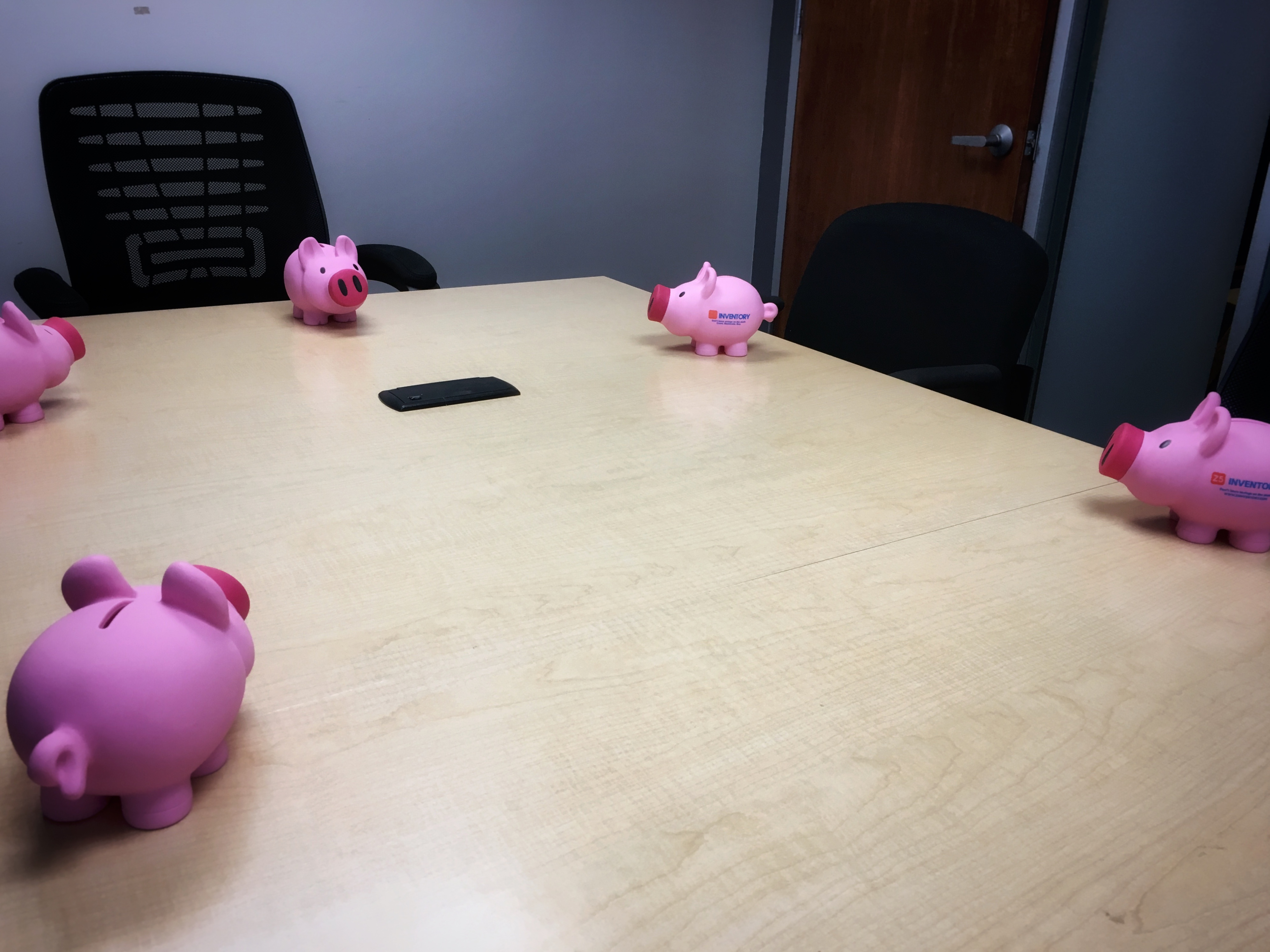 The Z5 Piggy Bank holding a boardroom meeting.