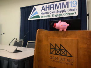 "The Z5 Piggy Bank sits on the podium that presides over AHRMM19 in anticipation of the presentation ""The Culture of Change."""