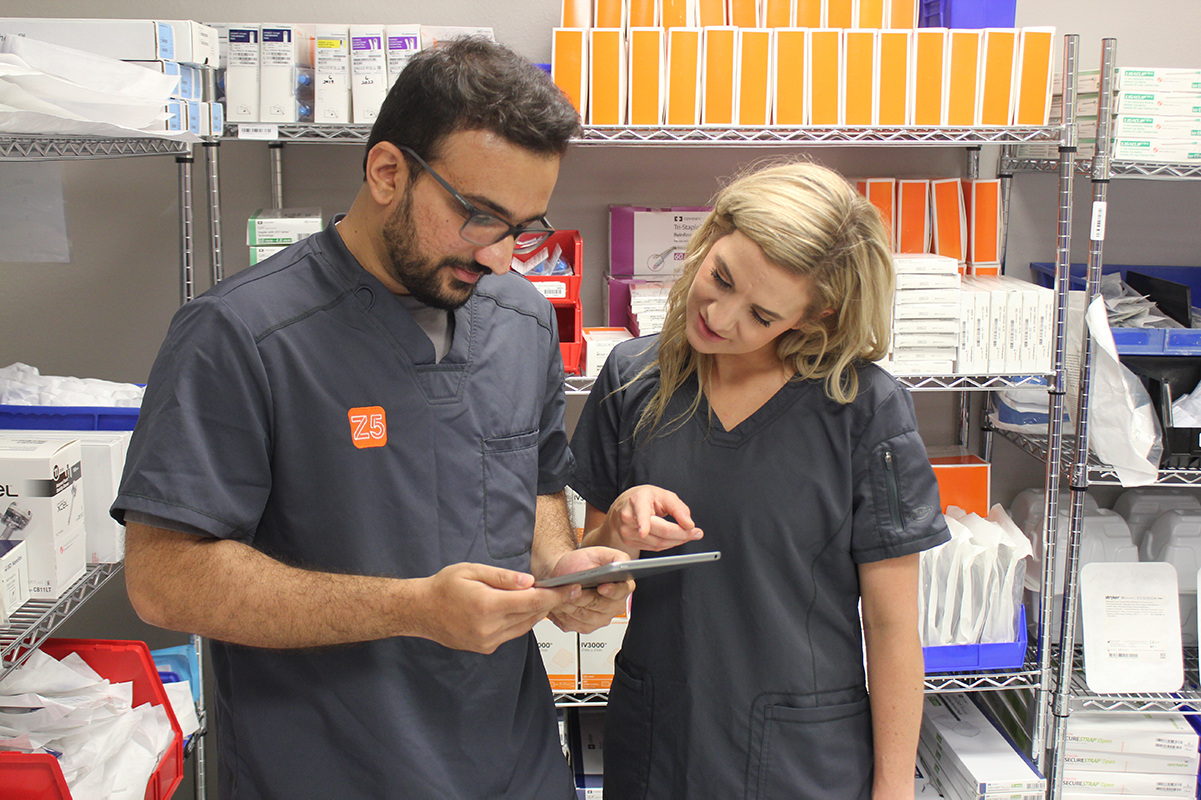 Z5 Reallocate specialists review a list of items to remove from a hospital before they expire.