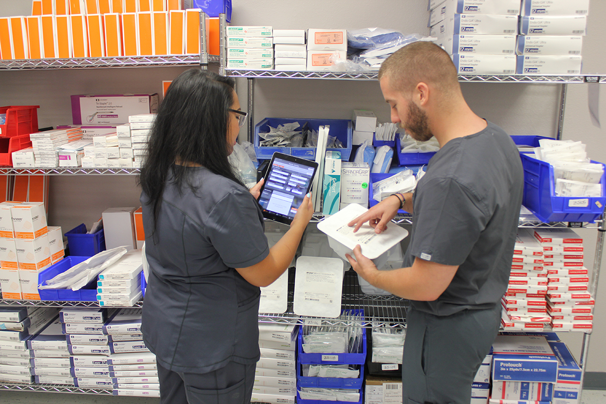 Two Z5 Reallocate pros sort through excess hospital supplies.