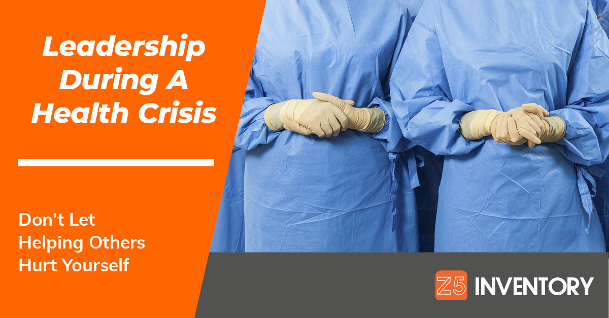 Clasped hands in PPE gloves indicate the need for healthcare leadership during a supply shortage.